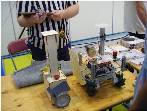 Secondary robot Danbot (left) and primary robot (right) about to go through homologation process.
