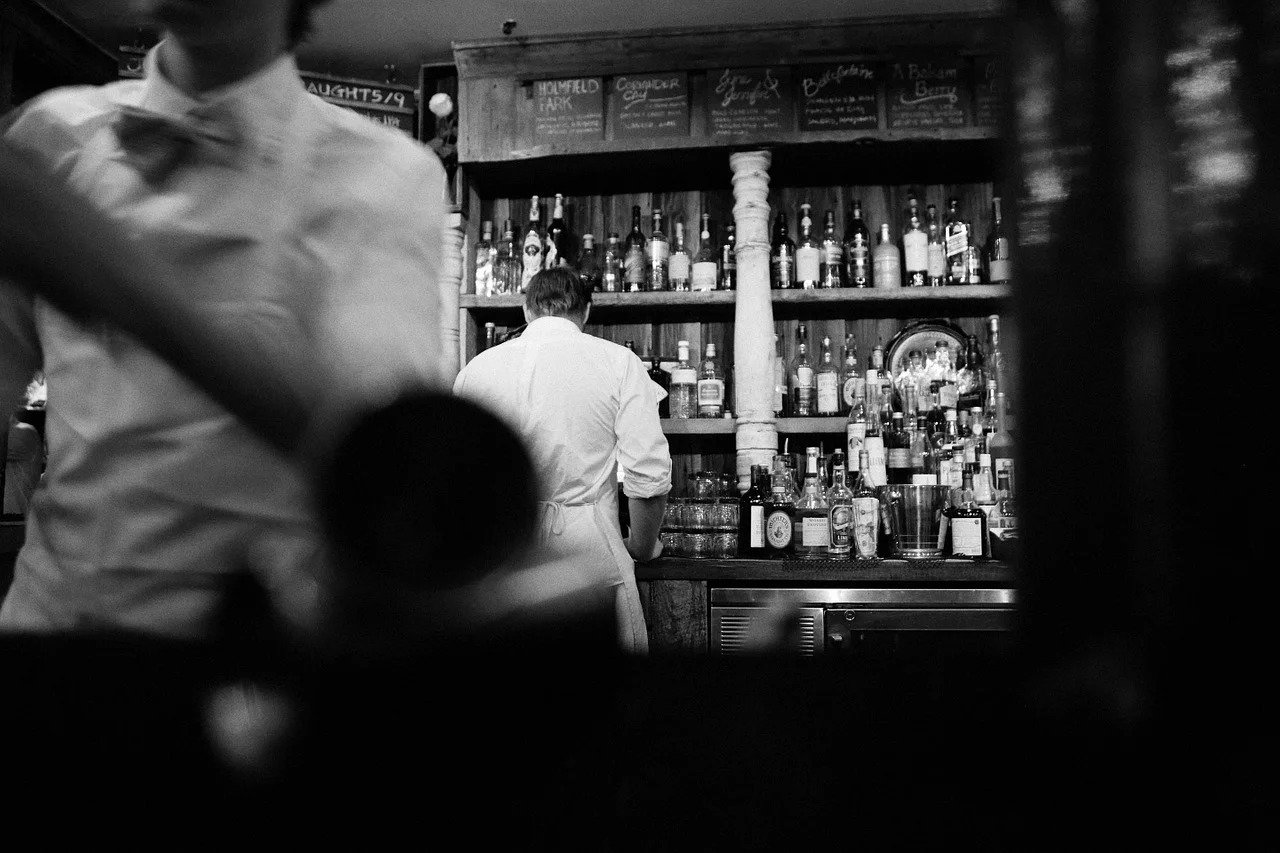 Waitressing at a bar, black and white photo