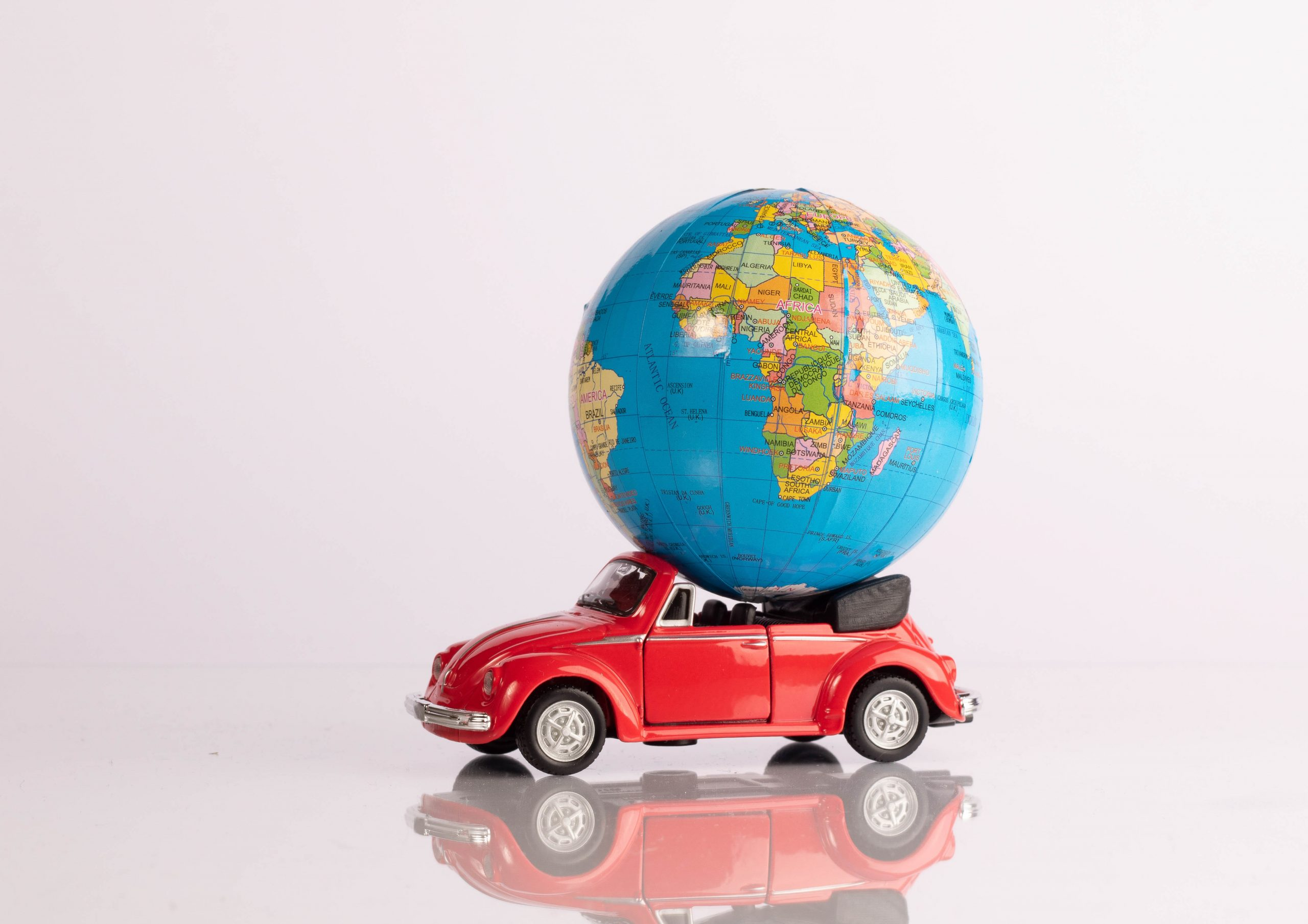 globe in a red car